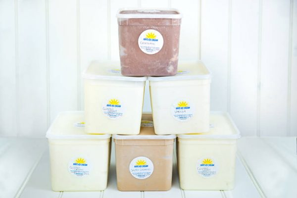 4L wholesale tubs of Rays Home Made Ice Cream stacked in a pyramid